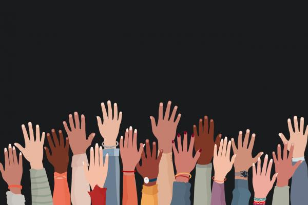 Hands raised against a black background