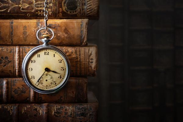 Old books and pocket watch
