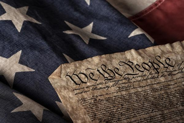 Picture of the U.S. Constitution and American Flag