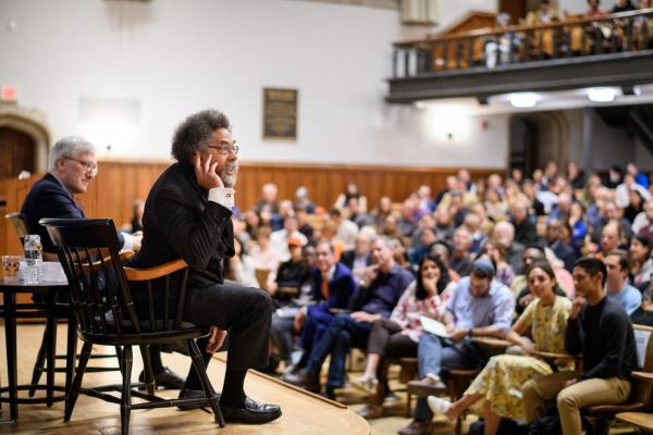 Robert P. George and Cornel West speaking to a large audience